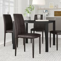 Round out your dining room ensemble or give the breakfast nook a polished upgrade with this set of four side chairs. Founded atop four tapered legs, its frame is crafted from wood and takes on a full-backed silhouette measuring 35'' H x 16.9'' W x 20'' D. Foam padding lends comfort to dinner parties and casual morning meals, while brown bonded leather upholstery ties it all together. Best of all, no assembly is required.