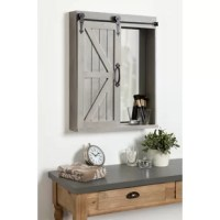 Decorate your home in vintage farmhouse style with this unique hanging wall shelf with an inset mirror and sliding barn door. Newly designed to include a paneled mirror on one side of the cabinet, this clever unit has lots of functionality to organize in a big way without using a lot of space. It'll work exceptionally well in a powder room as a unique vanity but it would also look and function great in an entryway, mudroom, kitchen, or bedroom. The single barn door slides to cover either side...
