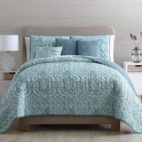 Whether making over your master suite or outfitting a hotel-worthy guest room, this six-piece quilt set lends your space a pleasant pop of pattern. Made from polyester microfiber, the machine-washable quilt features a rich paisley print in calming hues of seafoam green, gray, and white, while the reverse sports a solid-hued teal in a quatrefoil stitch to match with any aesthetic. Rounding out the set, two shams and a matching lumbar pillow echo the paisley motif, while a pair of square...