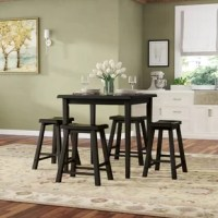 This 5 piece pack counter height dining set offers simplicity with a versatility perfect for any small dining space. This set boasts a space saving design, square leg table and four matching saddle style stools. The table features a solid wooden top and square legs in oak and black finish. The saddle stools include wooden seat and square legs complemented by 4 footrest supports.