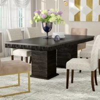 From everyday meals with the family to hosting friends at your next dinner party, this extendable table is a must-have for your dining room setup. Made from poplar wood with manufactured wood and resin, this table features a rectangular tabletop with a deep espresso finish, and is supported by two large columns with distressed accents. It measures 74'' L x 42'' W x 30'' H.