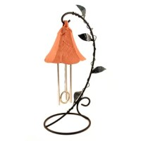 Bring your flower garden inside with this impressive indoor wind chime. Chime hanging from its underside become stamens ringing gently and true. The petals are textured and faceted, a metal leaf vine winds its way upward on the sturdy powder-coated stand. A solar chip captures the light of any kind, for energy. No batteries, no breeze no electricity ever required.