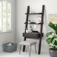 Turn any empty wall into a streamlined home office with this ladder desk. Crafted from manufactured wood in a dark cappuccino finish, this unit features an open, leaning ladder-style frame. Its wide desktop shelf is perfectly-sized for holding your laptop, while one drawer offers out-of-sight storage for office supplies. Up top, two hutch shelves are great for displaying books and accessories. Measuring 72
