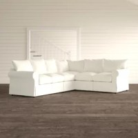 Anchor a living room or den with this traditional L-shaped sectional. Its plush back is filled with synthetic fiber, and its seat cushions are filled with a down blend consisting of a foam core wrapped in a down blend jacket and sinuous springs for comfort.