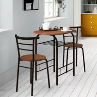 Create a compelling and cohesive aesthetic in your space with this three-piece dining set, which includes one table and two chairs. Perched atop curved metal legs, the oval table is crafted from manufactured wood, while the two chairs feature a ladderback design with tubular metal detailing. Awash in a neutral two-toned finish, this set blends with a variety of color schemes. The table measures 31.25'' L x 21'' W x 29.5'' H.