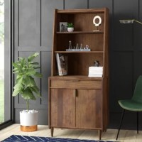 Mix mid-century modern style into your space as you get organized with this clean-lined cabinet. Crafted from manufactured wood in a warm grand walnut finish, this piece strikes a streamlined silhouette with tapered sides, conical legs, and angular metal hardware. Three open shelves let you show off books, serve-ware, and beyond, while a single drawer and a double-door cabinet offer concealed storage space. With a compact frame measuring 64.48