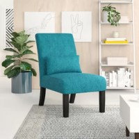 Whether you're searching for a spot to kick back or just looking to elevate your living room, this stylish slipper chair is the perfect pick. Founded atop four legs (two slightly tapered, two flared back) finished in espresso, its frame is crafted from solid wood and offers a clean-lined silhouette. Its seat is subtly sophisticated, boasting a foam fill and chenille upholstery in a versatile solid hue topped off with a matching boudoir pillow.