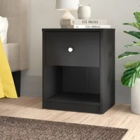Bring streamlined style to your bed's side with this one-drawer nightstand. Crafted of manufactured wood, this nightstand strikes a clean-lined rectangular silhouette. Set on smooth-operating plastic drawer glides, one drawer with a pewter colored handle offers out-of-sight storage for bedside essentials, while the nightstand's top surface provides a perfect platform for a phone charger and a stylish lamp. Measures 19.06