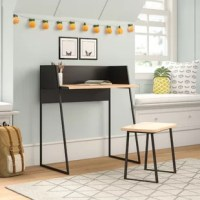 Whether used to complete homework assignments or for drafting a college admissions essay, this desk and chair set is a must-have for your teen's space. Crafted from a metal frame, the desk boasts a neutral black finish on its clean-lined frame, while a solid wood tabletop in a beige coloring creates a contrasting look. Plus, this set includes a matching backless stool that tucks neatly under the desk when not in use.