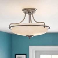 When it comes to good lighting, your fixture can make it or break it. Find the light you love with this semi-flush mount! Crafted from metal, it features curved arms and turned detailing, working well in a variety of aesthetics. A glass shade diffuses light from any compatible bulb up to 100 W, while a damp location rating makes it ideal for your bathroom or enclosed patio ensemble. Plus, it accommodates a dimmer switch, so you can set the perfect mood.