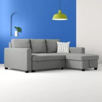 Founded on a solid and manufactured wood frame, this contemporary sectional strikes a classic L-shaped silhouette featuring a full back, track arms, and tapered block feet. Enveloped in gray polyester-blend upholstery, detail stitching lends a tailored touch, while foam and synthetic fiber-filled cushions and a pair of toss pillows provide added comfort and support. Expecting overnight guests? This sofa easily converts to a pull-out sleeper, while the chaise features hidden storage.