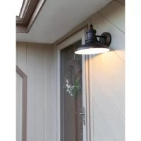 The Monterey Outdoor Down Light features an oil-rubbed bronze finish with an industrial metal shade. This fixture is perfect for back entry or garage lighting and provides warm consistent light. Meshing traditional aesthetics with an industry leading design, this glare-free light is perfect for your porch or yard.
