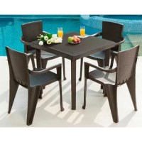 The dining set is finished in a rich espresso polypropylene (PP) resin material with an attractive Rattan® look. This set includes a table that is sturdy and easy to clean. It is ideal for any patio as it features a center opening with a removable cap that can accommodate a large shade umbrella (not included). Also included are 4 chairs with arms that are sturdy, easy to clean, and stackable for convenient storage. Both comfortable and stylish, this set is ideal for any patio, porch, or...
