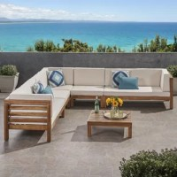This seating group offers a modular design that makes this the ideal centerpiece for any outdoor event. With solid acacia wood frames, plush outdoor cushions, and a slatted coffee table, this sectional can easily seat seven in both comfort and style.