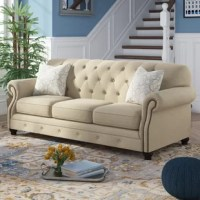 With its relaxed, inviting look, this sofa offers the perfect spot to park your keister and enjoy a good book or binge-worthy TV drama. Its rolled arms and diamond tufts are in step with traditional style, bringing classic comfort to your living area. Its solid and manufactured wood frame is upholstered in neutral linen-look upholstery and features removable seat cushions for easy upkeep.