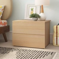 Steeped in Scandinavian style, this two-drawer nightstand brings a dash of modern minimalism to your teen's restful retreat as it offers a spot to stash bedside essentials. Crafted in Canada from particleboard and manufactured wood, this low-profile piece measures just 18'' H x 23.75'' W x 18.75'' D, so it's an ideal option for smaller spaces. A maple laminate finish outfits this design for an understated and natural touch. Assembly is required.