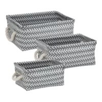 Brighten up your storage area with this basket set. Available in three sizes, each basket features two attached rope handles for easy transport. The woven pattern adds dimension and a pop of color to your office, living area, playroom or closet.