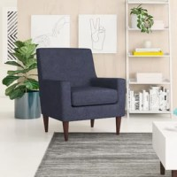 A traditional design gets a contemporary update in this streamlined armchair. Founded on a solid and manufactured wood frame, this armchair features a full back, track arms, and round tapered legs. Enveloped in polyester-blend upholstery, this armchair showcases detail stitching for a tailored touch, while coil springs and foam-filled cushioning provides comfort and support. Made in the USA, this armchair measures 34.5