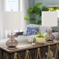 Illuminate your living room or master suite in tasteful, transitional style with this two-piece 25