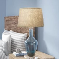 You've found the perfect lamp – now it's time to add the perfect shade to complete the look! This understated shade features a washer fitter, the most common type of fitter, so it's suited for a variety of lamps. Crafted from linen, its subtle empire silhouette features a textured look and a thick border for a touch of contrasting appeal. It measures 13'' top x 15'' bottom x 10'' height overall.