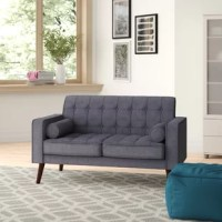 Whether you're adding to an existing seating group or looking to anchor a smaller living room, this loveseat is a tasteful addition to your space. Crafted from manufactured wood, its frame is filled with foam for a medium-firm feel. Plus, its 100% linen upholstery is designed to resist pilling and fading, and its button-tufted cushions gives this streamlined silhouette a touch of texture. Splayed legs, square arms, and two throw pillows round out the design with a hint of contemporary style.