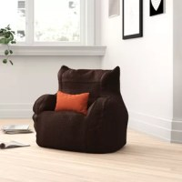 Right at home in the rec room or den, this fun bean bag chair provides laid-back seating alternative to the usual sofa. Borrowing its silhouette from a classic armchair, this piece measures just 25'' H x 21'' W x 15'' D overall, making it easy to tuck this seat away when it's not in use. A childproof zipper closure lets you safely remove the 100% polyester cover whenever it needs a pick-me-up (just toss in the washing machine), while refillable polystyrene beads within provide a bit of...