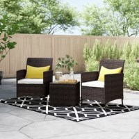 Entertain on your patio or porch with this three-piece conversational seating group. Founded on a sturdy steel inner frame, each chair features a full back, gently-flared arms, arched aprons, and four straight legs wrapped in tightly-woven wicker in a rich brown hue. A water-resistant white polyester-blend cushion lines each seat for padded comfort and support. Each chair has a 17.3