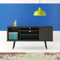 Mod style is made easy with this mid-century TV stand! Crafted of solid and manufactured wood, this TV stand strikes a clean-lined rectangular silhouette on four flared dowel legs. Arranged asymmetrically, three open shelves are perfect for housing your cable box and entertainment consoles, while two wood panel cabinet doors offer out-of-sight storage for A/V accessories. Weight capacity and can accommodate flat-screens up to 65
