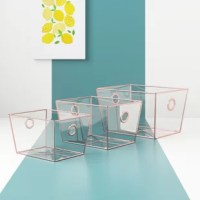 Looking for a chic storage solution? The answer is clear! This set of three plastic bins keeps all of your essentials corralled, whether they're perfumes, makeups, and more on the vanity or small-scale trinkets on the dresser in the bedroom. Crafted from clear plastic, each item features a gold-hued rim for a touch of glamorous appeal and circular handle cutouts that let you tote them from place to place with ease.