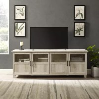 More than just a storage solution, this rustic and versatile TV stand also creates an eye-catching focal point in your living room, entryway, or seating arrangement. Made from engineered wood, it showcases smooth lines and a spacious surface top that's perfect for holding accent pieces and flatscreens up to 70