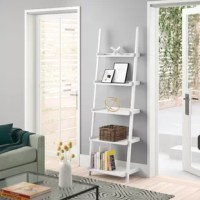 Make your space your own with this ladder bookcase, perfect for putting framed photos, artful accents, or a collection of novels proudly on display. Assembly is required. The manufacturer backs this product with a one-year warranty.