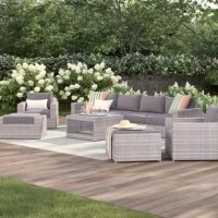 A weathered finish gives this wicker furniture an inviting look, while weather-resistant materials keep it looking comfortably lived-in, but not faded. This 9-piece outdoor conversation set is built from aluminum frames wrapped in all-weather resin wicker, so it stands up to everything from rain to UV fading. The set includes a large sectional sofa, two deep seating club chairs, and two ottomans, all topped with water-resistant olefin cushions. A coffee table with storage gives you room for...