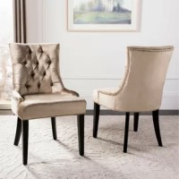 A cottage-chic twist on classic designs, this chair set brings style and seating to your home. Lovely addition to your dining room ensemble or living room arrangement, this two-piece chair set showcases a traditional slipper chair silhouette with four espresso-finished tapered legs and an arched back. The sage-toned cotton blend upholstery adds a soft touch to this chair, while the silver nailhead trim and deep button tufts round it out with chic flair.
