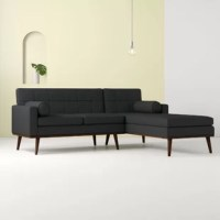 Bring trendy mod style to your space with this modular mid-century sectional! Founded on a birch wood frame, this sofa strikes an L-shaped silhouette with a full back and track arms, while its handsome walnut base features flared tapered dowel legs. Upholstered in brushed fabric, subtle button tufts give off retro-chic vibes, while web suspension, thick foam cushioning, and a pair of bolster pillows provide comfort and support.
