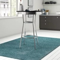 Bring a touch of retro style to your abode with this stylish pub table. Crafted from metal, it features four slanted legs connected by a circular footrest down below. Its polished chrome coloring lends a touch of what's contemporary while it's round tabletop boasts a neutral black or white for a look that's versatile enough to blend with both monochromatic or more vibrant color palettes. Measures 41.75'' H x 30'' L x 30'' W.