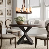 Squares, circles, rectangles, ovals: what dining table shape best fits your needs? A round table cuts out the corners, creating a cozier, more intimate space where everyone can see everyone else at the table. Plus, it's the perfect space-saver. Like this table, for instance: Crafted from solid acacia wood, it features a pedestal base with a salvaged gray finish, the ideal anchor for your modern farmhouse-inspired kitchen or dining nook.