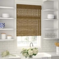 Give any room a bright and breezy feel by outfitting an open window with this Roman shade, a semi-sheer design that lets in natural light. Made from bamboo wood, this piece showcases a natural brown hue for a warm and traditional touch, while the included valance offers a layered look. Best of all, this shade is cordless, so it's a safe option for homes with kids and pets. Installation is required.