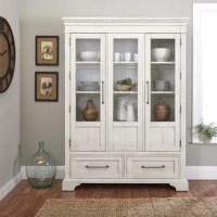 Composed of clean, classic lines, this china cabinet from the Trisha Yearwood Home Collection is the perfect place to display your treasured pieces. Glass doors allow you to see the three roomy shelves inside, while two bottom drawers are perfect for stowing extra pieces or silverware. The doors and drawers feature subtly antiqued hardware for a casual look.