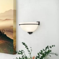 When it comes to mood lighting, your light fixture can make it or break it. Find the light you love with this wall sconce. Crafted from metal and glass, it boasts a half-moon shape, creating a statement-making appeal in your abode. A white opal glass shade diffuses light from any standard bulb up to 100 W, brightening up your space in style. Plus, this light is compatible with a dimmer switch, so you can create the perfect ambiance whenever you please.