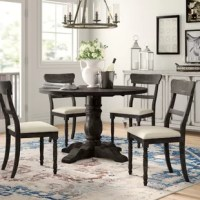 Whether you're creating a cozy kitchen breakfast nook or decking out a smaller dining room, this classic five-piece dining set is an ideal option for your home. Crafted from solid rubberwood and manufactured wood, this set includes one round table with a turned pedestal base and four matching side chairs that can each support 300 lbs. A weathered pepper finish outfits the frames for an understated and antiqued look, while off-white linen upholstery cushions the square seats for an inviting...