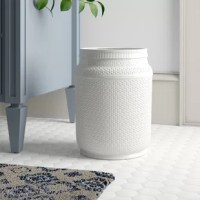 Sometimes even the smallest thing can make the biggest difference in a room. Take this wastebasket, for example: crafted from ceramic, it showcases a textured finish in a crisp hue, making it the perfect subtle addition to a bathroom or bedroom remodel. Measuring 12'' H x 9.25'' W x 9.25'' D, there's plenty of space to toss in all your bathroom or bedroom trash. To clean, wipe with a damp cloth.