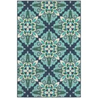 Bring a pop of pattern and a soft touch to any space inside or outside your home with this delightful area rug. Machine-made from 100% synthetic polypropylene with a loop pile type, it is stain- and weather-resistant, and stands up well to high-traffic. Showcasing a medallion awash in tones of blue, turquoise, green, and white, it is a lovely anchor for coastal and nautical ensembles, but you can also use it to round out a more classic look.