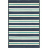 Nautical style abounds with this eye-catching polypropylene rug, defined by ivory and blue stripe motif. Its multicolor palette pairs perfectly with hardwood floors for a contrasting look, while its understated silhouette blends effortlessly into any casual aesthetic. Lean into the rug's influences by having it anchor a seafaring entryway ensemble, comprised of a clean-lined open-x base console table topped with wood mermaid figurines and sailboat statuettes. Adorn nearby walls with vintaged...