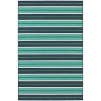 Bold, bright, and breezy, this blue and green area rug showcases stripes in several sizes for a classic pop of pattern. This durable design is machine-woven in Egypt from polypropylene – a synthetic material that resists water, staining, and fading – making it an ideal anchor for indoor and outdoor arrangements alike. Thanks to its low 0.15