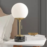 More than just illumination for your abode, table lamps lend artful appeal to your space as they shine. Try adding one to your teen's nightstand to give their restful retreat a mini makeover, or stage one atop the entryway console to greet guests with a warm glow. Take this one for example: offering a touch of modern style, it showcases a circular base made from marble, a sleek brass frame, and a globe-inspired glass shade.