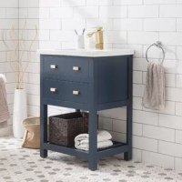 Add streamlined style to your powder room with this vanity, a must-have in any abode. Crafted from manufactured wood, it features a neutral-hued finish designed to pair well with ensembles from modern to transitional, while an integrated ceramic sink completes the look. One functional drawer makes room for washcloths and other essential toiletries, while a slat-style lower shelf gives you a space to tuck away spare linens. A faucet is not included. Optional Matching Faucet F7-0001 available in...