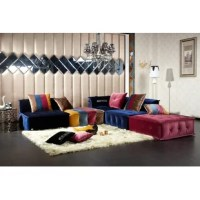 This modern sectional is an eclectic piece that provides an eye-catching and inviting appearance. Along with its fun color scheme, it features beautifully tufted upholstery and will provide inspiration to your living space.