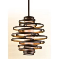 The chandelier adds elegance to your decor. This Chandelier light has a cylindrical caramel ice shade, with bronze and golden leaf finish accents that make it look classy. It is a captivating adornment for a contemporary room decor. The iron construction provides maximum strength and durability for the light. This light can be placed in the living room, dining room, entryway, or hallway. It is available in numerous sizes. The vertigo hanging Chandelier by Corbett Lighting requires simple...