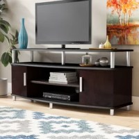 Anchor your den in streamlined, contemporary style with this TV stand. Crafted of manufactured wood with laminate veneers, this TV stand strikes a rectangular silhouette on metal feet. Two shelves are great for housing your cable box and entertainment console, while two side cabinets offer out-of-sight storage for A/V accessories. Elevated by five metal posts, the top panel provides a perfect platform for your flat-screen, while the shelf created below is great for displaying a soundbar.