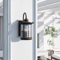 A modern take on a vintage lantern design, this one-light wall lantern brings extra curb appeal as it boosts the brightness in your space. Rated for use in wet locations, this fixture features a rectangular backplate, a gooseneck arm, and a cylindrical body in an oil-rubbed bronze finish for an understated look. Clear seeded glass makes up the shade, providing a peek at a single LED medium-base bulb (included) ensconced within.